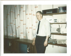 William in his showroom, selling RCA and Zenith TVs and radios.